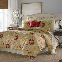 Add a touch of color to your master suite or guest room with this floral-print cotton comforter set. Its traditional pattern reverses to ticking stripes for ...