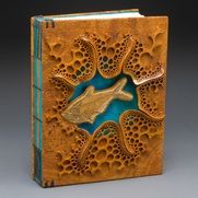 """""""Fossil Fish"""" book by Mark Doolittle.  Wood covers carved from Afzelia Burl.  Binding by Kathy Doolittle."""