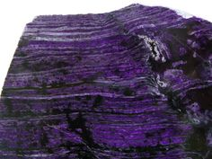 Sugilite Slice from Wessels Mine, Northern Cape, South Africa / very fine specimen of Sugilite slice polished on one side. Nice colour and pattern.