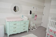 Gray and White Striped Accent Wall in this Mint, Pink and Coral Nursery