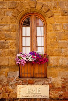 Arched window with flower box