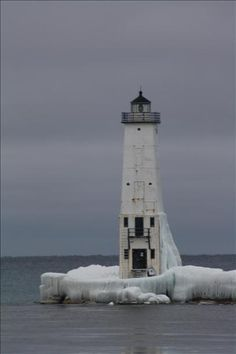 Frozen lighthouse in Frankfort Michigan