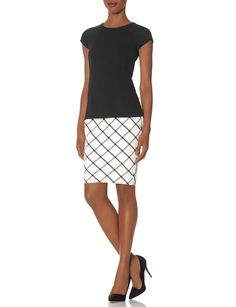 Check Pencil Skirt is perfect for a day at the office and Owning The Room.  Found at THELIMITED.com