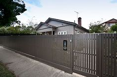 Modern fence and gates, contemporary fencing: Horizontal boards and vertical square pickets, compressed sheet supplied and installed Melbourne.