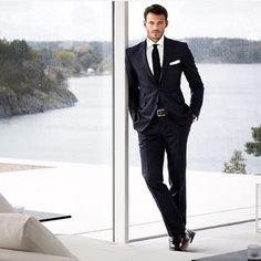 Follow @mensdailypost @mensdailypost Welcome home Navy blue pinstriped suit paired with a crisp white shirt and pocket square, a black tie, a black leather belt and black leather shoes.