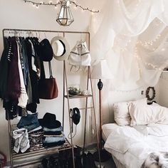 Urban Outfitters Bedroom | I love how the canopy is bunched up to look like a cloud. I'm thinking of making a romantic-style canopy with a cloud corner above my head like this but with poly-fill and lights.
