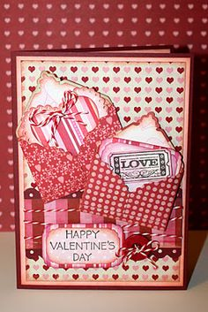 Mini envelopes were cut withe the wild card cart, and scalloped heart was cut with Sweethearts cart..nice job..