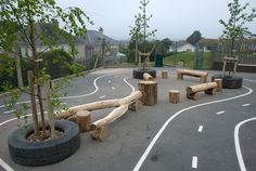 Low cost natural elements added to a basic Tarmac play space this could be what we need Playground Build & Design | Natural Child Play | Earth Wrights Ltd This Could go round our bike track to make it more interesting.