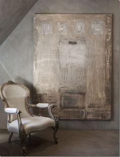 In the master bath, a fancy, highly carved wood chair, sits next to an unexpected contemporary canvas. Belgian design is all about the mood, the quiet colors, the sparseness of the interiors against the vastness of the architecture, and the textures – the rough, rustic touches mixed with smooth, shiny crystals and glass.