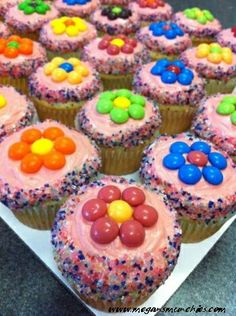 Yummm daisy cupcakes using m&m or skittles candies