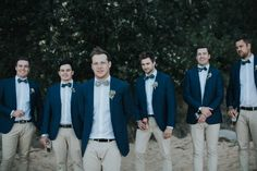 casual groomsmen in chinos and navy blazers
