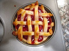 """Tiny pies! Hers are gorgeous but I cheated: 4"""" circles of premade pie crust in a mini muffin tin + canned pie filling, pinch edges, bake 375* for 10-12."""