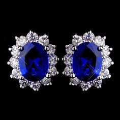 A classic oval cut cubic zirconia crystal surrounded by smaller cubic zirconia makes these stud earrings sparkle and alluring. This simple yet glamorous piece is eye catching and the perfect piece to
