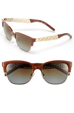 The gold gilded, logo perforated along the temples lend and iconic gleam to these retro-vibe Tory Burch sunnies.