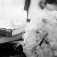 Wedding Decor: Books, Candle, Flowers, Feathers (Duston Todd Photography)