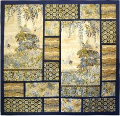 Chandler's Cottage large panel quilt pattern. Would be great for large prints too. In beige/gold/grey.