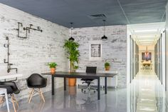 """Reception is lined with weathered white-washed wood planks from <a href=""""http://timelinewood.com/"""" target=""""_blank"""">Timeline Wood</a> in contrast with the polished floor."""