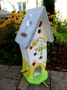 Big bird house, a nice gift for the wedding, birth or baptism. Painted with a stork on the roof, hearts, leashes with baby clothes and toys. Large Bird Houses, Bird Houses Painted, Bird House Plans Free, Seasoned Wood, Diy Bird Feeder, Big Bird, Wooden Wall Art, House Painting, Diy For Kids
