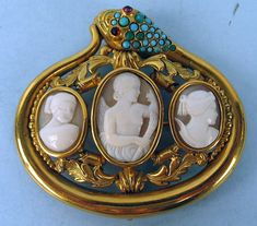 Unique!  Antique Triple Cameo brooch with a 14k gold snake setting, Head of snake has Turquoise stones and Ruby Eyes,