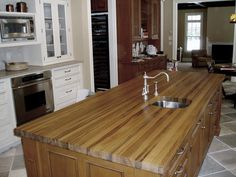 Teak edge grain kitchen island with undermount sink cutout.