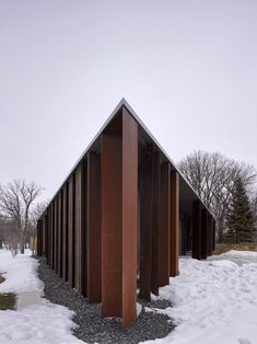 Its angular walls create four distinct corners on the home's exterior, which is clad in dark wood boards laid vertically and panels of Corten steel.