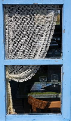 crocheted curtains....love the blue window