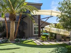The water slide built in our Las Vegas home is a great way to make a splash this summer! Who's ready to swim?