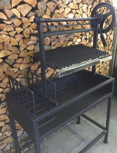 Argentine Grill with Side Brasero   BM G-2 It's an ultimate wood/charcoal burning grill pit on the stand for home and small catering business use. These Argentine barbecue grills feature heavy duty black steel construction with a side brasero(ember maker) to make embers for authentic Argentine style cooking, and a traditional sloped Argentine style angle iron grill grate with a drip pan.  Argentine Grills …