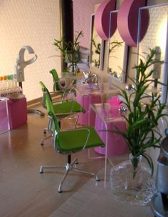 This beauty shop reflects a fun and feminine atmosphere. The colors chosen set the perfect mood as customers enter. By using glass tables and vases, the space is kept light and airy.