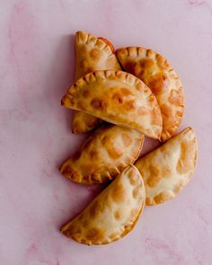 Last week was National Empanada Day and I missed it. But it's never too late to celebrate a good empanada! I made these beauties with different filling flavors like ground beef, cheese, and vegetables. Also, I don't like to fry food much and I baked them in the oven. They came out delicious. What is your favorite empanada filling? Gourmet Recipes, Appetizer Recipes, Easy Recipes, Snack Recipes, Easy Meals, Appetizers, Snacks, Fry Food, Yogurt And Granola
