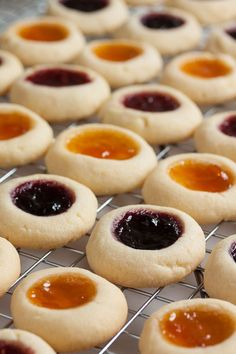 Jam Thumbprint Cookies – perfect little morsels of soft buttery cookie filled with a variety of sweet jams. Always a favourite! Jam Thumbprint Cookies – perfect little morsels of soft buttery cookie filled with a variety of sweet jams. Always a favourite!