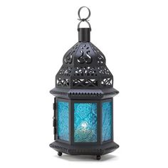 Blue Glass Moroccan Style Candle Lantern Ocean blue is the color of serenity, beautifully showcased in this intricate metalwork Moroccan lantern. Ornate cutouts allow a candle' golden light to provide a fascinating counterpoint of lacy light! Moroccan Lanterns, Moroccan Decor, Moroccan Style, Moroccan Bedroom, Lantern Candle Holders, Candle Lanterns, Cheap Lanterns, Garden Lanterns, Hanging Lanterns