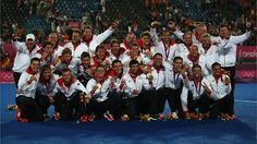 Team Germany celebrates with their gold medals during the medal ceremony following the men's Hockey gold medal match against Netherlands