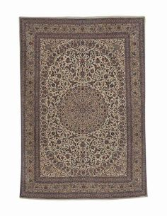 NAIN CARPET   CENTRAL PERSIA, CIRCA 1970   With a signature cartouche bearing the inscription: Sherkate Sahamie Farshe Iran (Iran Carpet Company)  Approximately 14 ft. 2 in. x 10 ft. (432 cm. x 305 cm.)
