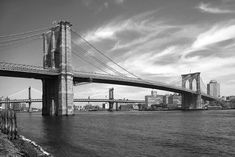 Brooklyn Bridge. At the time the bridge was built, the aerodynamics of bridge building had not been worked out. Bridges were not tested in wind tunnels until the 1950s, well after the collapse of the original Tacoma Narrows Bridge (Galloping Gertie) in 1940. It is therefore fortunate that the open truss structure supporting the deck is by its nature less subject to aerodynamic proble