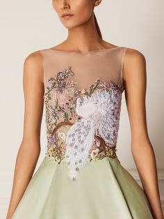Hamda AlFahim Fall Winter 2015 Dress. It has a pistachio green taffeta gown skirt, with a skin color tulle sleeveless top with full embroidery handmade by skilled artisans in the UAE in the Hamda AlFahim workshop. It has a beautiful peacock embellishment, and some of the designer's reflections on the art of Chinoiserie with branches, vines, flowers done by experimented embroidery techniques -- such as silk ribbon, thread, etc. bringing a beautiful, modern fantasy to life.