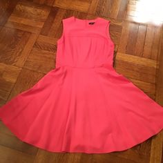 Sweet and sassy NANETTE LEPORE salmon dress Beautiful salmon colored fit and flare dress by Nanette Lepore. Size 4. Excellent condition!  Can't ship until 6/1 Nanette Lepore Dresses Midi