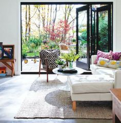 Awesome sliding doors and tufted white leather couch.