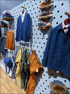 Wood Pegged Wall of Blue Pegboard in Apparel Merchandising