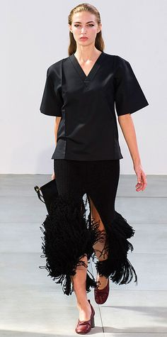 Fantastic skirt with a top one wouldn't expect to work. The two balance each other out wonderfully.
