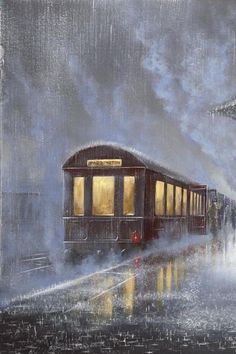 The rain leaving the train station in pourin rain. It looks cozy inside the softly lit train car. : The rain leaving the train station in pourin rain. It looks cozy inside the softly lit train car.