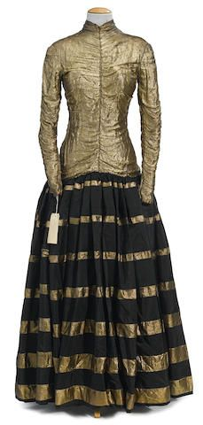 """Floor-length gown with gold lamé    high neck top and full black taffeta skirt with gold stripes. Worn by Doris Day as """"Judy Adams"""" in It's a Great Feeling (1949)"""