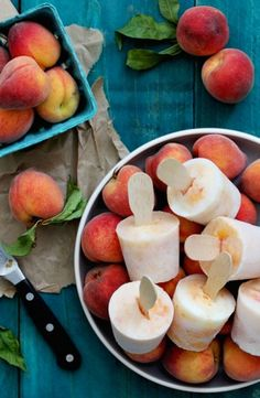 Bourbon Peaches and Cream Popsicles Bourbon Peaches and Cream Popsicles Makes 18-22 popsicles · 1 cup ripe peaches, crushed · ¼ cup bourbon · ½ cup simple syrup, cooled (recipe follows) · 2 cups plain yogurt Instructions: 1. Peel and slice peaches. Use a potato masher to crush the peaches. Combine crushed peaches and bourbon in a bowl, mix to combine. Add the simple syrup in slowly and taste to preference. Add yogurt to bourbon peach mixture and combine. 2. Score top edge of Dixie cup with…