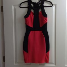 Never Worn Hot Coral & Black cage dress Pretty and comfy! Spandex to conform to your shape. Neckline is cool to show off shoulders and neck! Perfect condition Baileyblue Dresses Midi