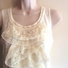 NWT Romeo & Juliet Couture Ruffle Tank Stunning lace ruffles on a Racerback pullover tank. Color is Ivory. Also comes in mauve and size small. 100% viscose. Trim is 50% viscose 50% nylon. No trades. Discount with bundle. Romeo & Juliet Couture Tops Tank Tops