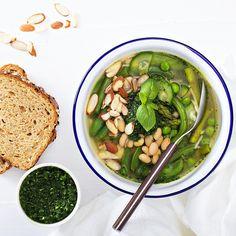 """Spring vegetables minestrone with beans, almonds and pesto // Минестроне с весенними овощами, фасолью и песто. Я думала, что такие супы, кроме меня в семье никто есть не будет, а нет - уже второй раз младшенький выхватывает ложку, практически урча и попискивая. Рецепт похожего супа был недавно под фотографией похожего супа. """"Молодо-зелено"""" для #фудфотоапрель_413 от @foodphotomonth."""