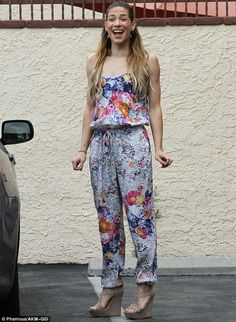 Happy! Alison Holker donned a floral jumpsuit and platform high heels