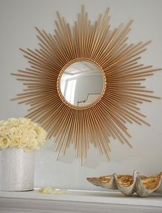 A touch of class with a gorgeous sunburst mirror!