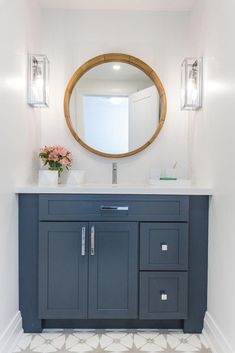 Bathroom Decor countertop This is very pretty. I like the white walls and countertop with the blue vanity and the round mirror Bathroom Renos, Bathroom Flooring, Bathroom Renovations, Master Bathroom, Home Remodeling, Bathroom Ideas, Bathroom Cabinets, Mirror Bathroom, Decorative Bathroom Mirrors
