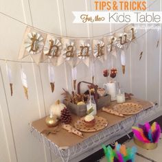 Glam Up Your Thanksgiving Decor: 5 DIY Ideas ~ gold sparkle dipped feather banner, feather headbands, table settings, and more! {VeryJane Blog}